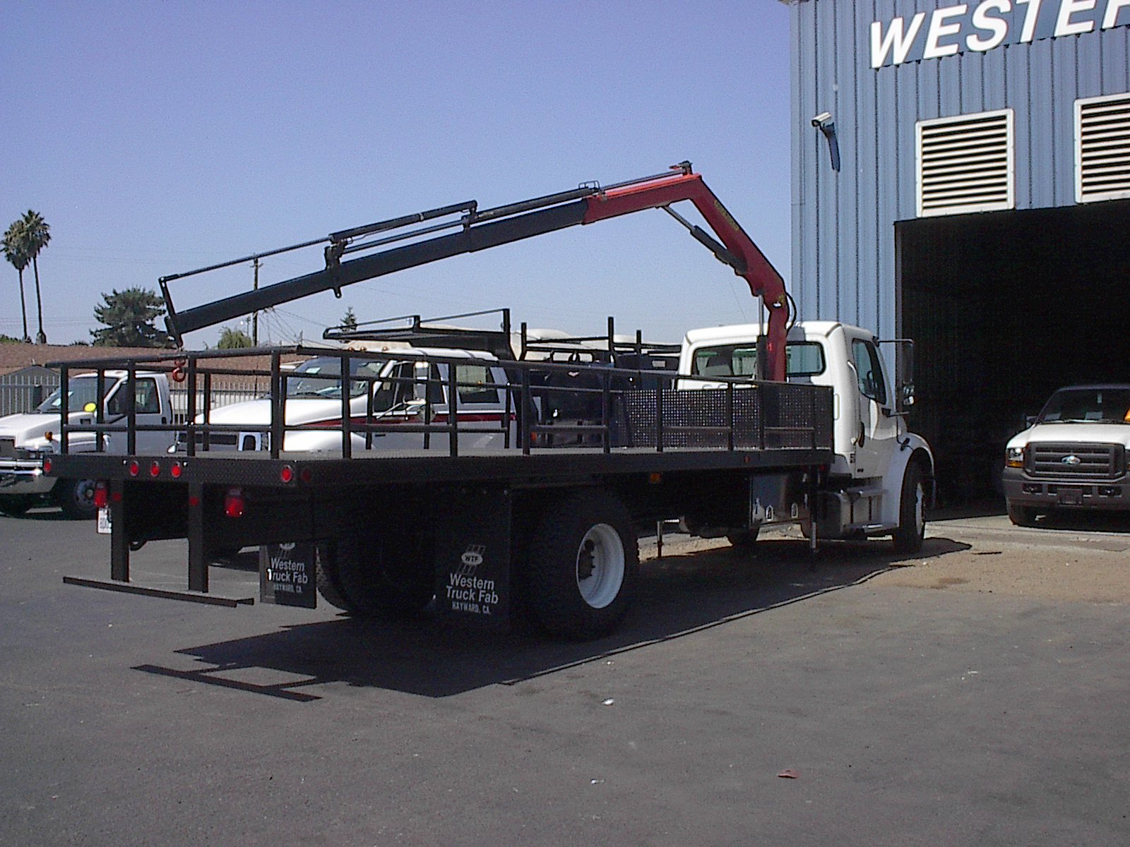 Long reach crane on a flatbed truck
